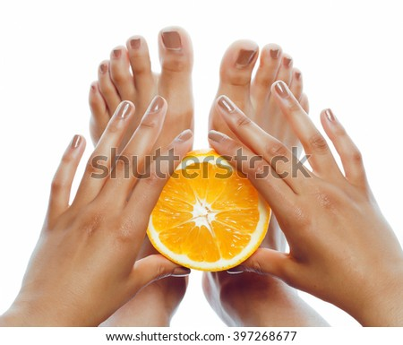 manicure pedicure on afro-american tann skin hands holding orange, healthcare concept