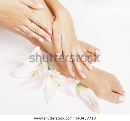 manicure pedicure with flower lily close up isolated on white perfect shape hands feet - stock photo