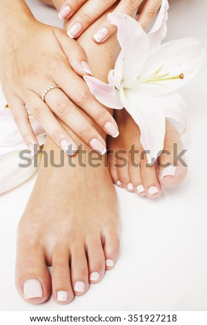 manicure pedicure with flower lily close up isolated on white perfect shape hands feet spa - stock photo