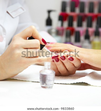 Manicure process... Female hands... - stock photo