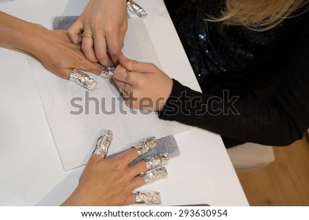 Manicure process in a beauty salon, a closeup - stock photo