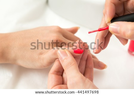 Manicure process in beauty salon close up of female hands - stock photo