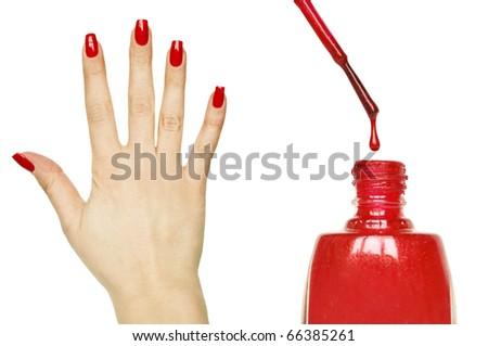 Manicure set - Beautiful red manicured woman hand and nail polish - stock photo