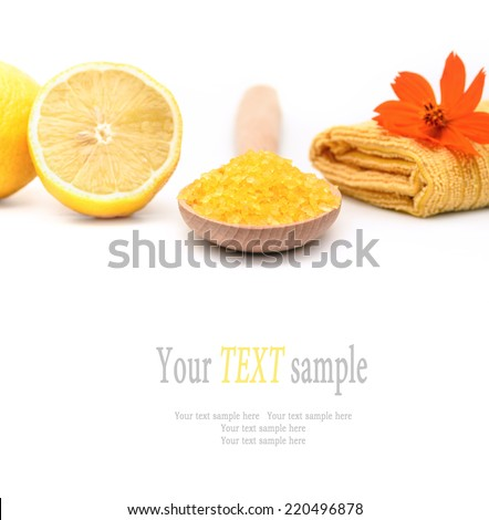 Manicure set with yellow sea salt and lemon. Spa and wellness setting isolated. Relax and treatment therapy. White background. Selective focus. Close up. - stock photo