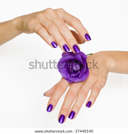 Manicure spa pampering with delicate flower - stock photo