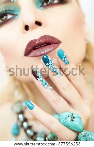 Manicure with blue and brown lacquer decorated with beads and turquoise.