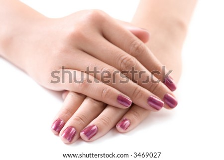 Manicured female hands isolated against white background