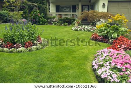Manicured Yard.  A beautifully manicured residential yard full of blossoms. - stock photo