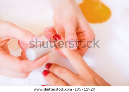 Manicures, spa treatments for hands, hand care, the girl in a beauty salon, body care - stock photo
