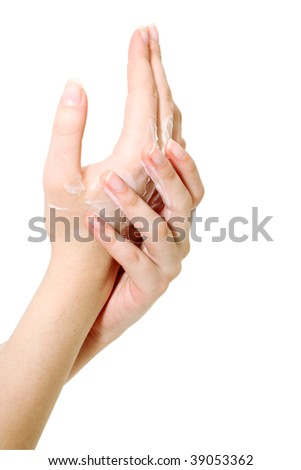 Manicuring, the girl rubs a cream in hands. - stock photo
