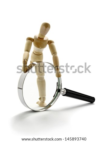Manikin and magnifier - stock photo