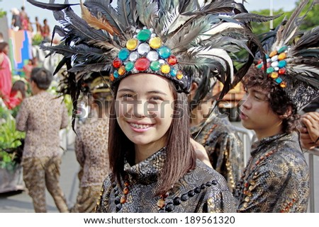 MANILA - APRIL 26: Contingent from different parts of the country celebrate  The 2014 Aliwan Fiesta on April 26, 2014 in Manila Philippines.  Performers dressed with ethnic costumes they represent.  - stock photo