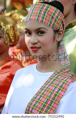 MANILA - APRIL 16: Contingent from different parts of the Philippines celebrate The 2011 Aliwan Fiesta on April 16, 2011 in Manila Philippines. Performers dressed with ethnic costumes they represent. - stock photo