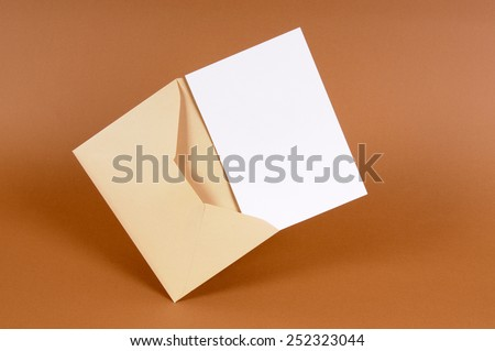 Manila envelope, blank card. - stock photo