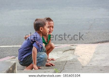 MANILA - FEB 11: Unidentified street of children on 11 Feb, 14 in Manila. Children of the street make their homes on the street which make up 25%-30% of the street children in the Philippines. - stock photo