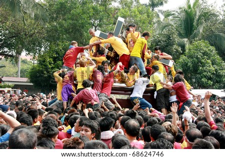 MANILA - JAN. 9: Devotee celebrate the feast of The Black Nazarene on January 9, 2011 in Manila Philippines. The fiesta celebrated by thousands devotee parading the image in the city. - stock photo