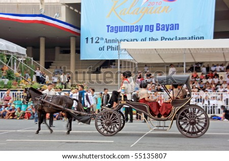 MANILA - JUNE 12: Filipino celebrate The Philippine Independence Day on June 12, 2010 in Manila, Philippines. The Independence Day commemorates the 112th anniversary with parade & exhibitions. - stock photo