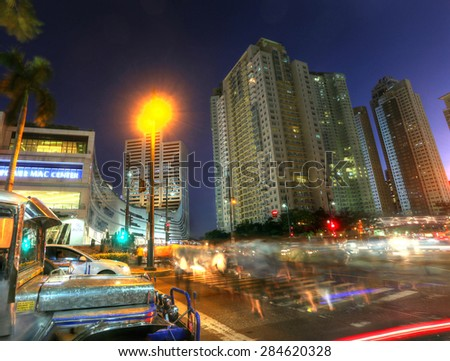 MANILA - MAY 17: Sunset of Bonifacio Global City in Taguig City on May 17, 2015 in Manila, Philippines.  In recent years, the district has experienced robust commercial growth. Focus in buildings. - stock photo