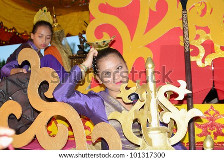 MANILA, PHILIPPINES - APR. 14: pageant contestant in her cultural dress pauses during Aliwan Fiesta, which is the biggest annual national festival competition on April 14, 2012 in Manila Philippines. - stock photo