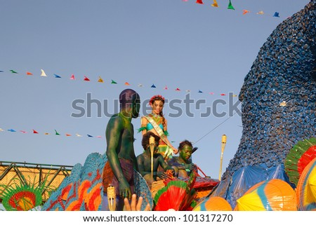MANILA, PHILIPPINES - APR. 14: parade contestant in her cultural dress on bird float during Aliwan Fiesta, which is the biggest national festival competition on April 14, 2012 in Manila Philippines. - stock photo