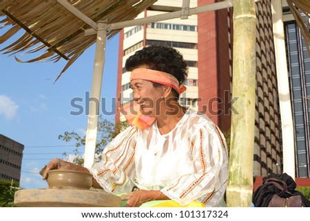 MANILA, PHILIPPINES - APR. 14: parade contestant making clay pot during Aliwan Fiesta, which is the biggest annual national festival competition on April 14, 2012 in Manila Philippines. - stock photo