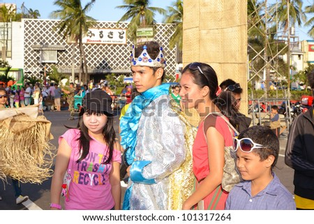 MANILA, PHILIPPINES - APR. 14: photo opp with contestant during Aliwan Fiesta, which is the biggest annual national festival competition on April 14, 2012 in Manila Philippines. - stock photo