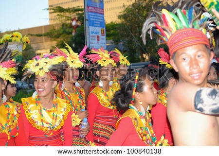 MANILA, PHILIPPINES - APR. 14: street dancers in their cultural dress  during Aliwan Fiesta, which is the biggest annual national festival competition on April 14, 2012 in Manila Philippines. - stock photo