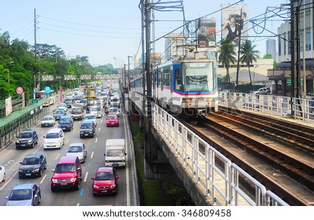 MANILA, PHILIPPINES - APRIL 03, 2012: LRT train on a railroad in Manila, Philippines. LRT serves 579,000 passengers each day. Its 31 stations along over 31 kilometers
