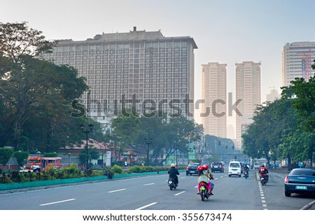 MANILA, PHILIPPINES - APRIL 01, 2012: Morning traffic on the street in Manila, Philippines. Metro Manila is the most populous area in the Philippines with an estimated population of 16,300,000  - stock photo
