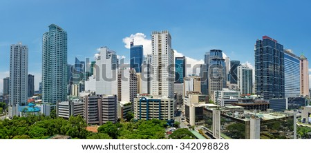 Manila, Philippines - AUGUST 19, 2014: Makati district of Manila - business, shopping and nightlife centre of the city - stock photo