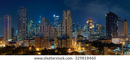 Manila, Philippines - AUGUST 19, 2014: Skyline of the Makati district - business, shopping and nightlife center of the city - at night - stock photo