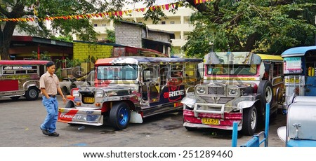 MANILA, PHILIPPINES -CIRCA JAN 2015-Colorful old Jeepney buses are the most popular mode of public transportation in Manila, the capital of the Philippines.