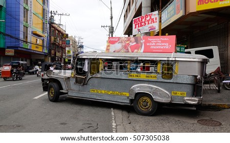 Manila, Philippines - Dec 20, 2015. A jeepney running on street at downtown in Manila, Philippines.