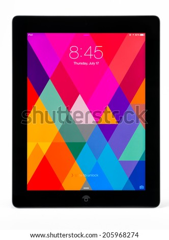 Manila,Philippines - July 17, 2014: Apple Ipad 4th generation (Retina Display) with with iOS 7. iOS 7 new operation system from Apple Inc. It  was released on September 18, 2013. - stock photo