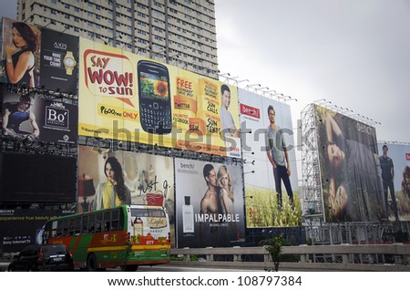 MANILA, PHILIPPINES - JULY 15: The Philippines capital, Manila is home to more than 12 million.  The approach to the city features large advertising billboards, on July 15, 2012, Manila, Philippines - stock photo