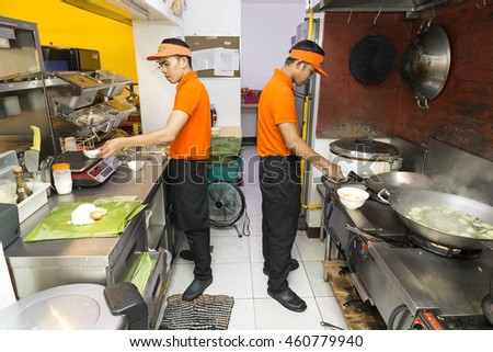 Manila, Philippines - July 22, 2016: Two guys working at the kitchen