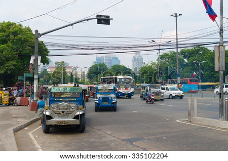 MANILA, PHILIPPINES - JUNE 7, 2015: Jeepneys in the streets of Manila. Jeepneys are the most popular means of public transportation in the Philippines. - stock photo