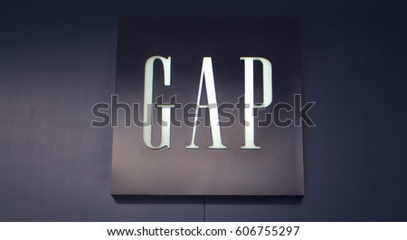 "Manila, Philippines - 26 June, 2016: Logo of famous brand ""Gap"" in Mall of Asia, Manila, Philippines. Casual clothes and denim shop. Mass-market unisex wear. Fashion store entrance. Retail industry"