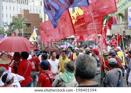 MANILA, PHILIPPINES- JUNE 12: Protester at The Philippines Independence day on June 12, 2014 in Manila. The Philippines celebrate the 116th Independence Day. - stock photo