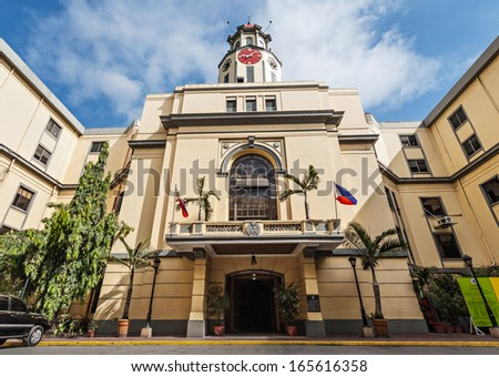 MANILA, PHILIPPINES - MARCH 18: The clock tower of the Manila City Hall on March, 18, 2013, Manila, Philippines. The Manila City Hall is one of the distinct landmarks in Manila, in the Philippines. - stock photo