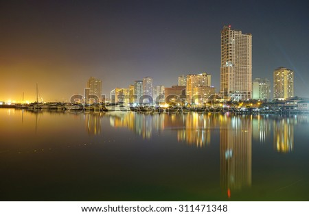 Manila, Philippines - May 11, 2015. Night view of Manila Bay and Manila Yacht Club from Harbour Square in Manila, Philippines.