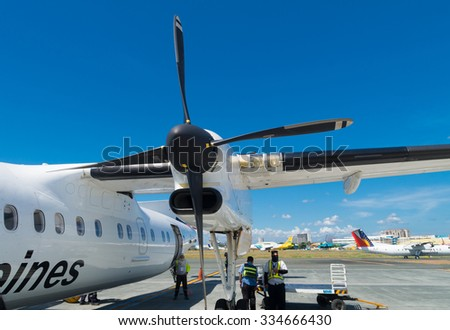 MANILA, PHILIPPINES - MAY 13, 2015: Propeller jet of Philippine Airlines (PAL). Since July 10, 2013 the airline is no longer on the blacklist of the European Union. - stock photo