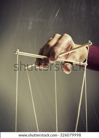 Manipulating arm on a dark  background scratched - stock photo