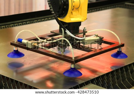 Manipulator for moving the sheet materials in industry - stock photo