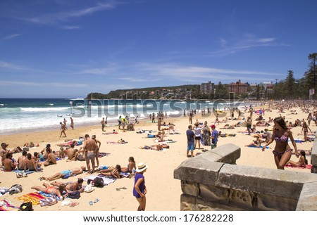 """MANLY, AUSTALIA-DECEMBER 08 2013: Manly beach on busy, sunny day. The beach was declared the """"Manly-Freshwater World Sufing Reserve in March 2012. - stock photo"""