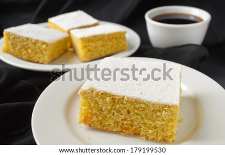 manna cake with candied fruits and coffee on black background - stock photo