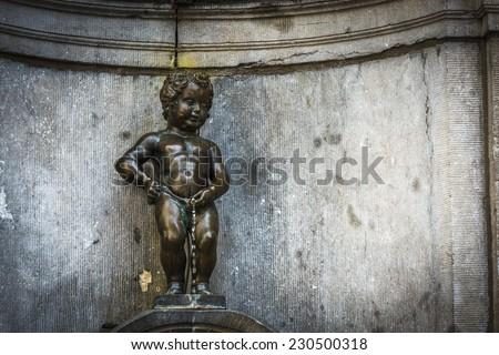 Manneken Pis (Little man Pee) or le Petit Julien, a landmark small bronze sculpture in Brussels, Belgium - stock photo