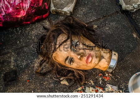 Mannequin doll head was left in a garbage dump / Head of dirty mannequin Doll/ Dirty mannequin doll head was left in a garbage dump (doll, mannequin, garbage) - stock photo