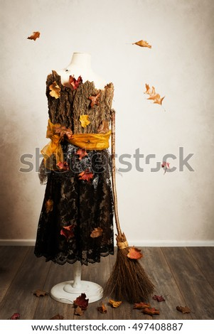 Mannequin dressed for the fall with besom and leaves