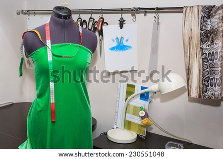 Mannequin dressed in gown to be in the studio fashion designer clothing - stock photo